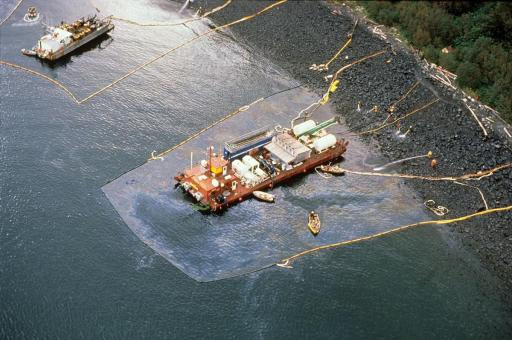 Aerial view of a maxi-barge and spill workers.